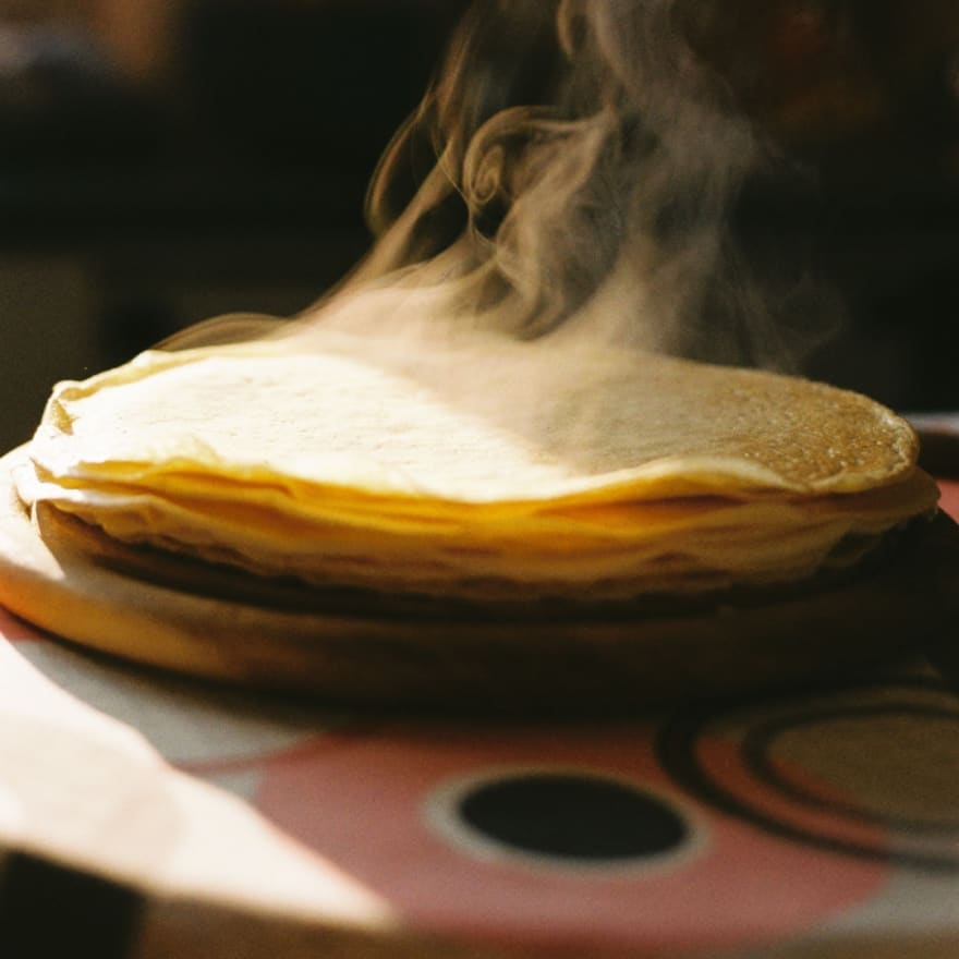 A stack of steaming tortillas.