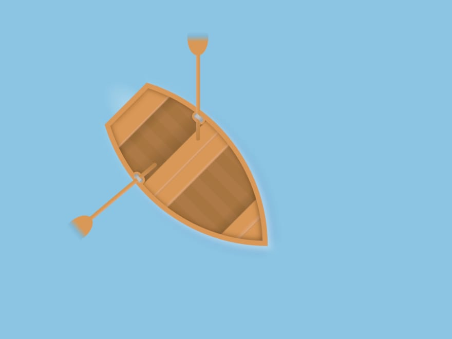 Wooden boat with two oars floating on the water
