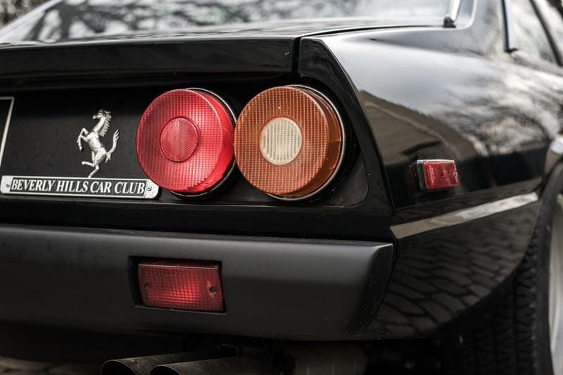 A closeup to the back lights of an old Ferrari