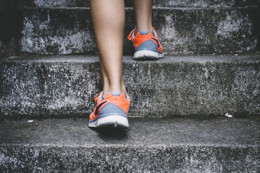 image of feet running up stairs