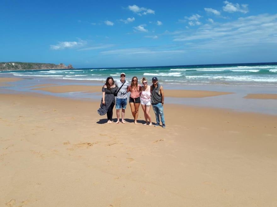 5 friend stood on Australian Beach