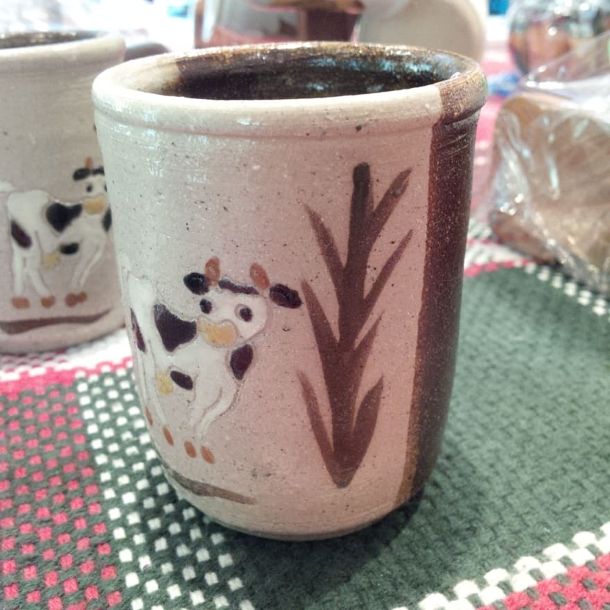 mud cup with cow