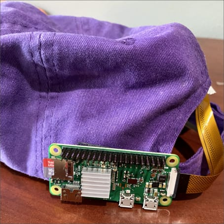The pi mounted to a hat