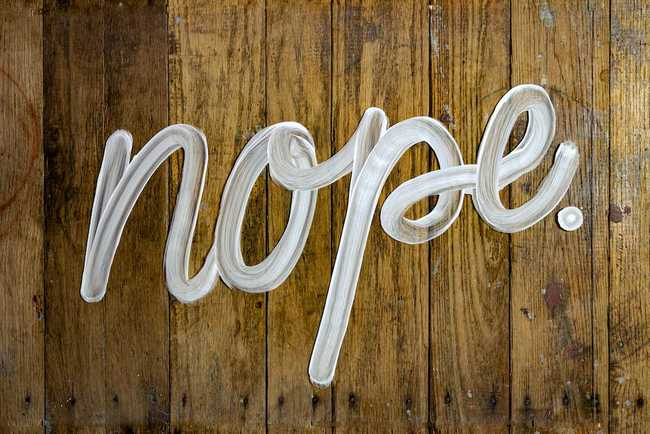 "Photo of the word ""nope"" in cursive by Daniel Herron on https://unsplash.com/photos/vBxbZokRL10"