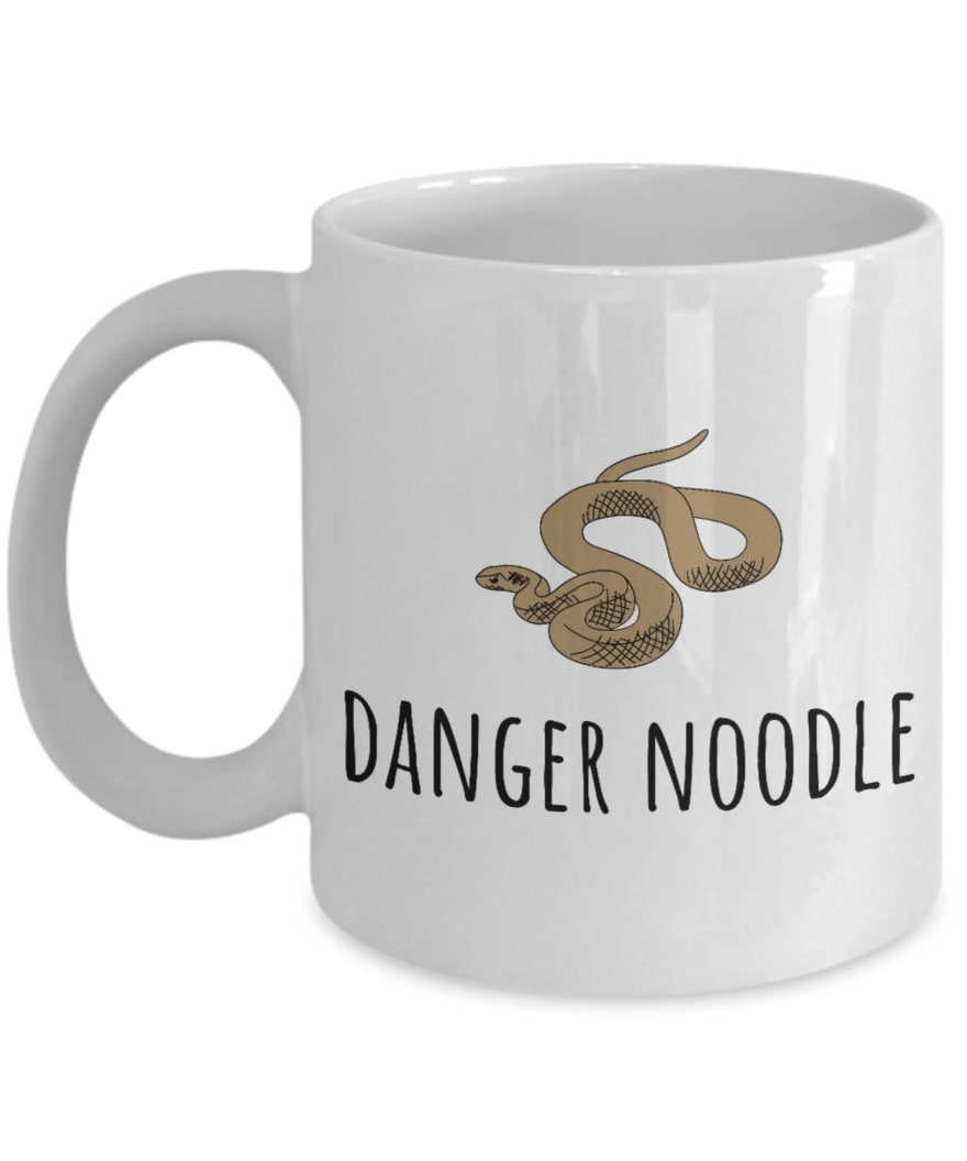 Danger Noodle mug with snake drawing