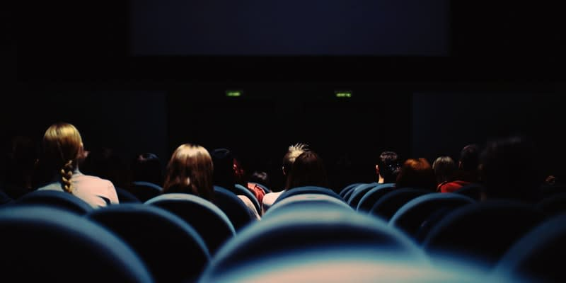 Waiting at a cinema before a movie starts