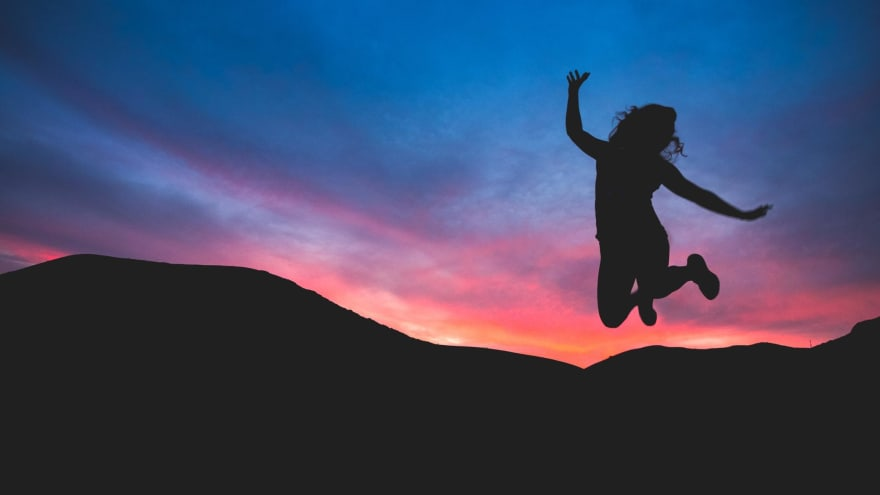 Image that symbolizes success, a person jumping with a happy pose