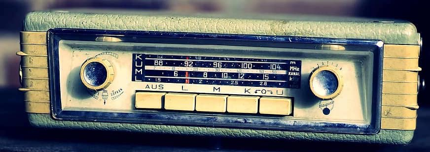 Old car stereo with radio buttons