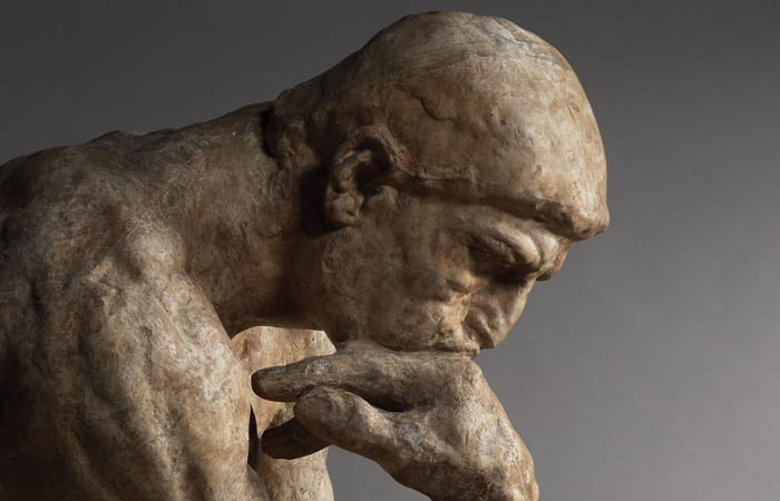 Close up of head of Rodin's The Thinker statue