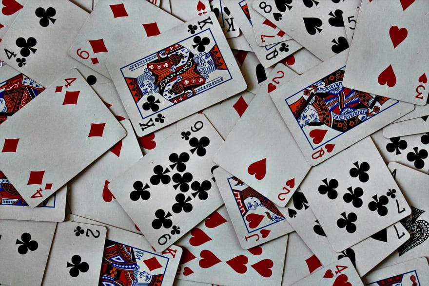 Playing cards Photo by Amanda Jones on Unsplash