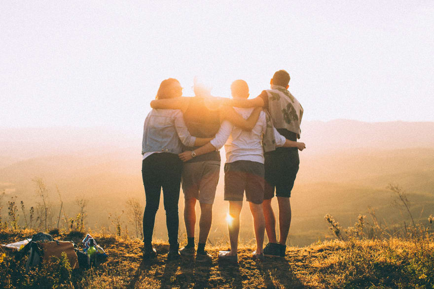 4 people hugging - @wildlittlethingsphoto