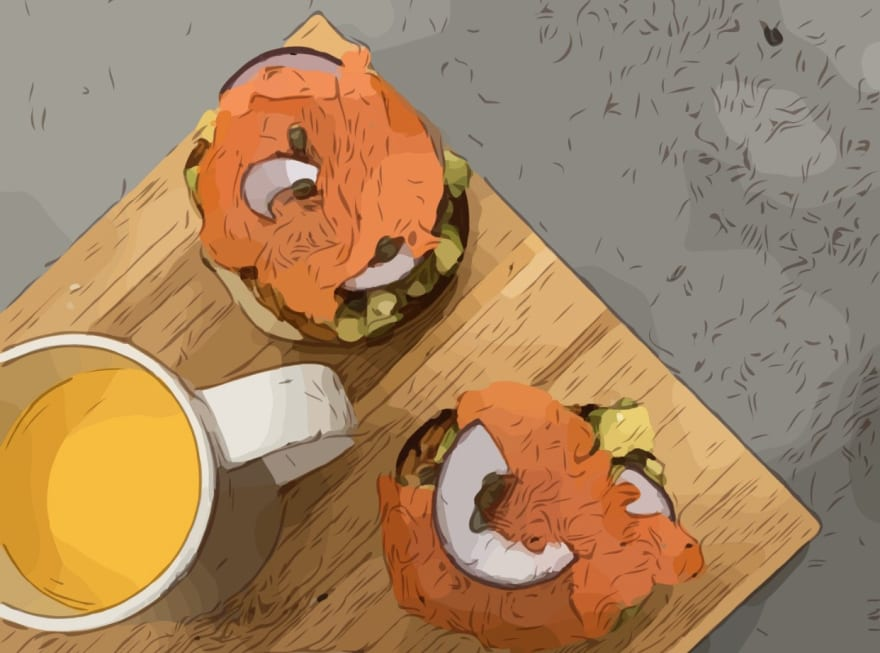 breakfast: orange juice, avocado bagel with salmon, onion andeggs