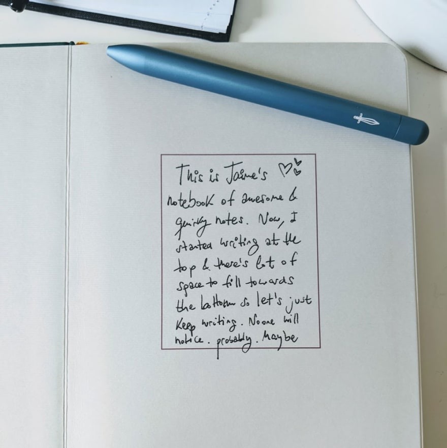 The first page of a baronfig notebook and a blue pen. There's a note that says: This is Jaime's notebook of awesome and quirky notes.