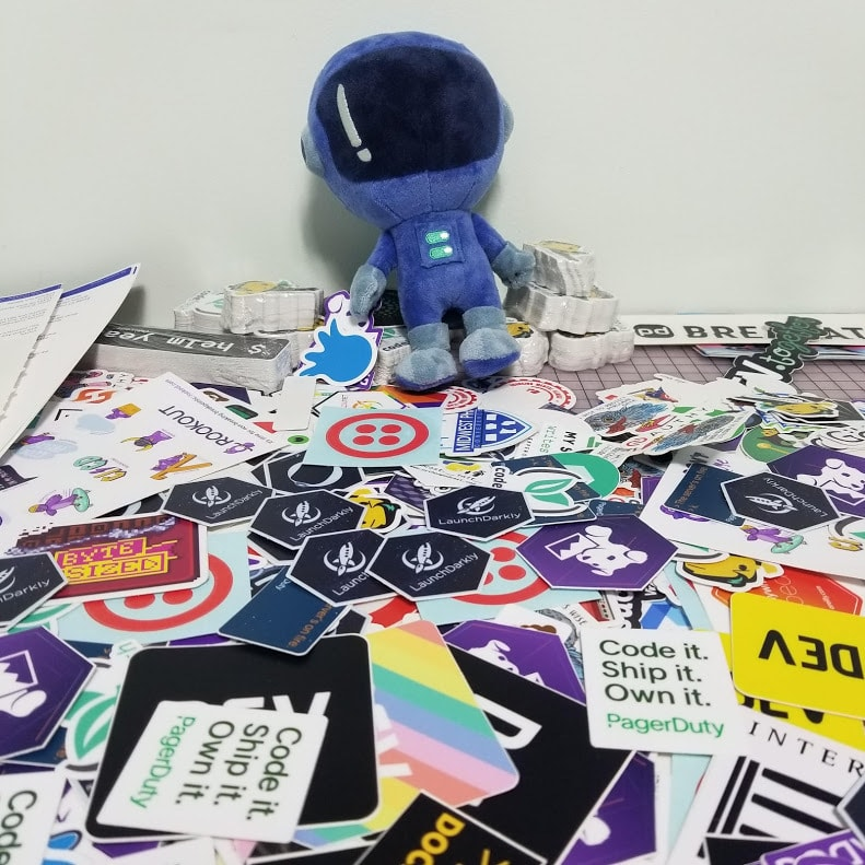 Plushie Toggle character presides over a sea of technology stickers