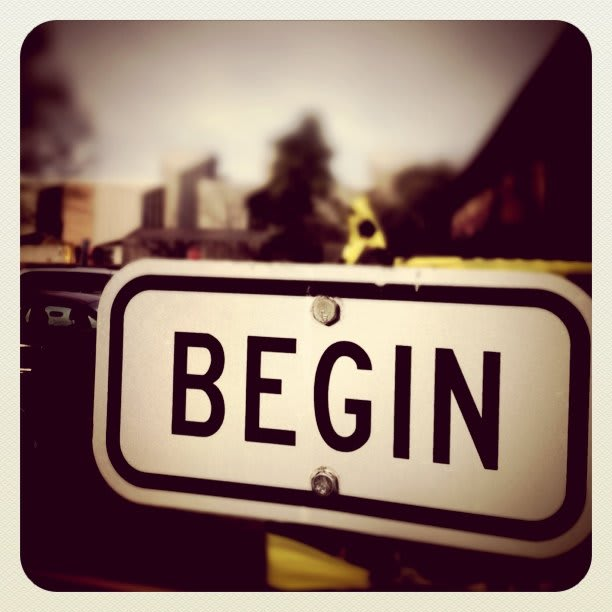 "a sign that says ""begin"""