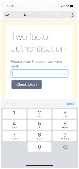 A web page shown in iOS Safari with a two factor authentication prompt. This time a simple keyboard of just numbers appears.