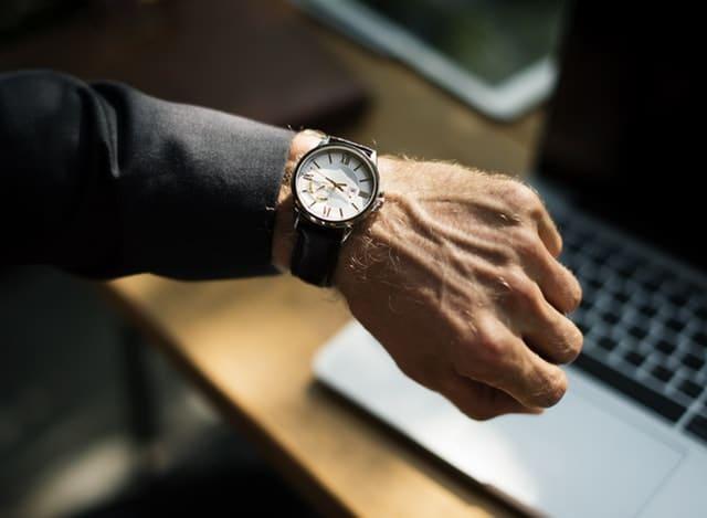 Man with a wrist clock