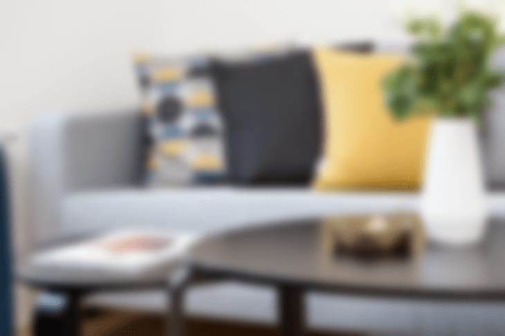 Blurred Image of a Sofa, Coffee Table, and Pillows