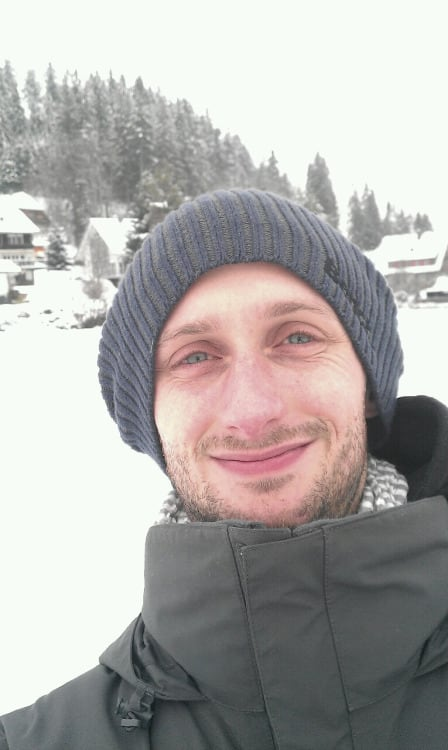 Marco in the snow with a blue beanie on his head