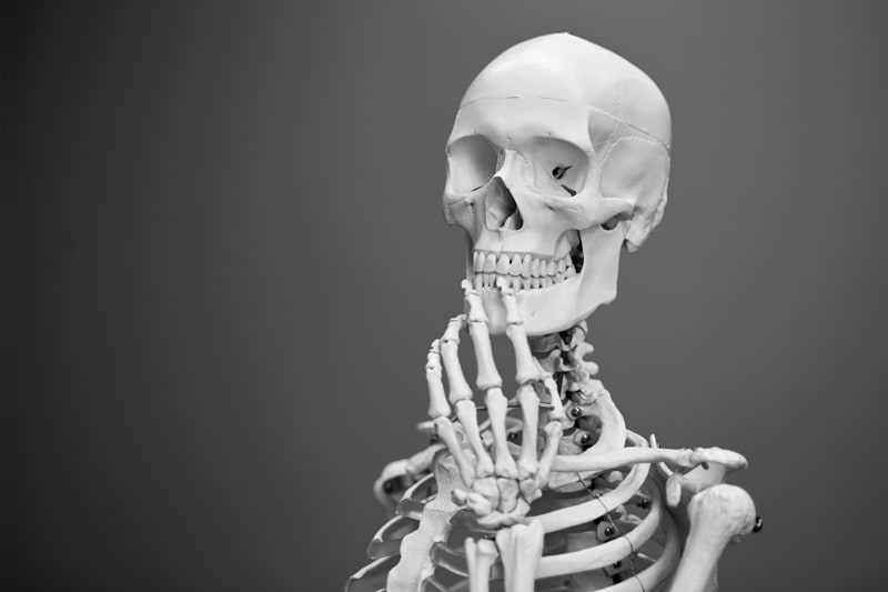 A skeleton, deep in thought