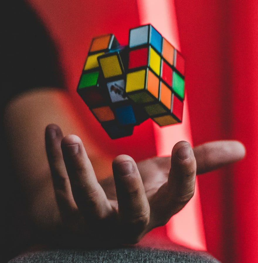 Rubik Cube floating above a hand