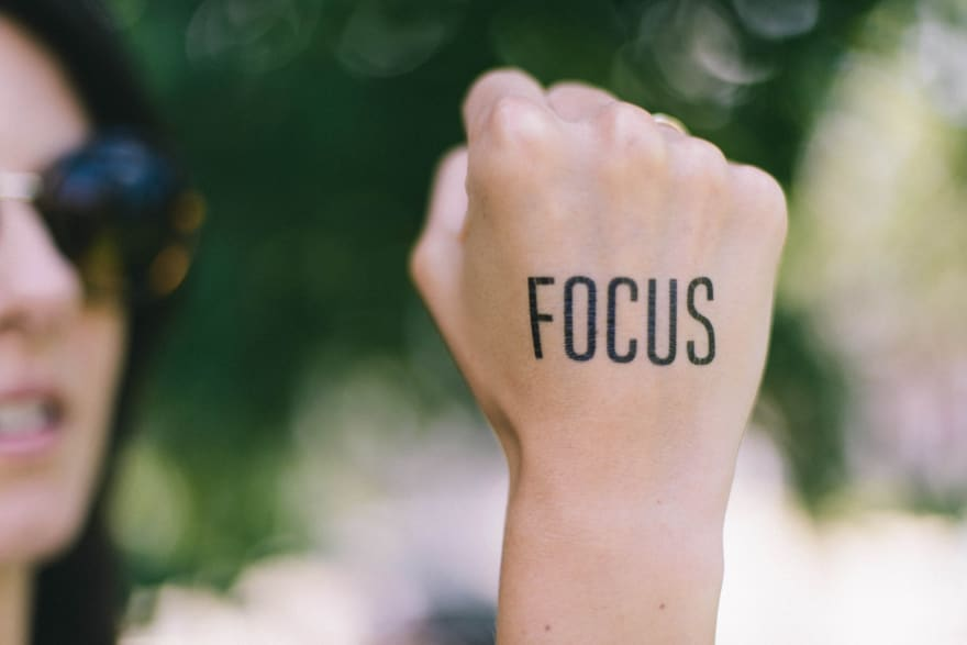 "A woman has ""focus"" tattooed on the back of her hand"