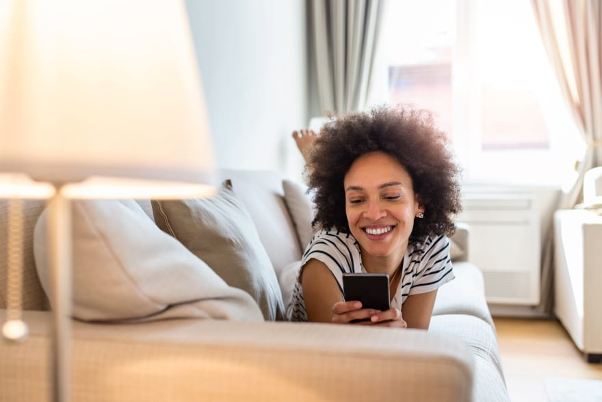 Woman on couch using mobile app