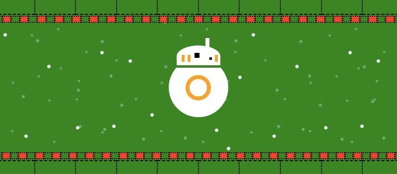 bb-8 on a green ugly sweater. It is snowing.