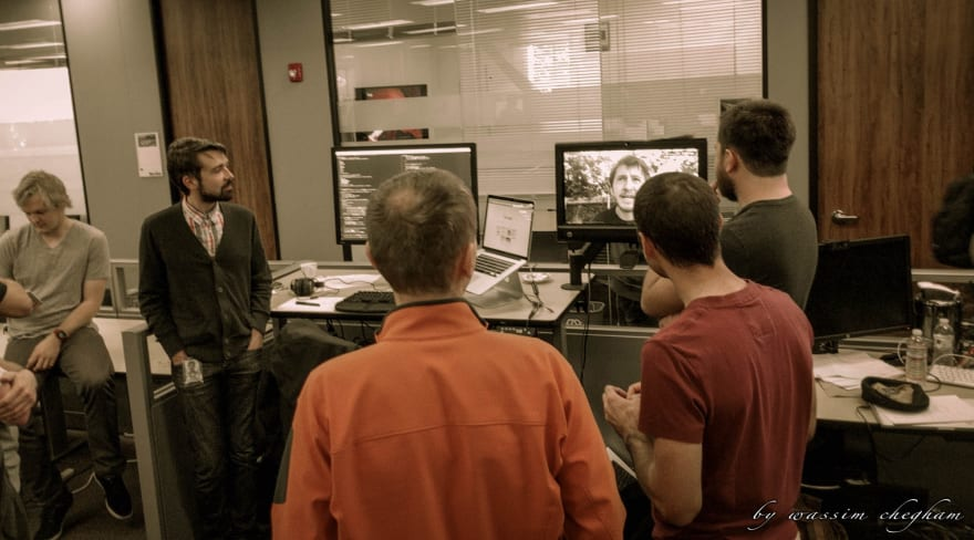 from left to right: Matias Niemelä, Victor Savkin, Igor Minar (in orange shirt), Rob Wormald (on screen), Victor Berchet (in red shirt), Jeff Cross.