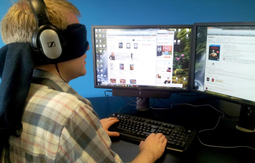 A blindfolded person using laptop