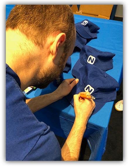 sebastian giving out autographs