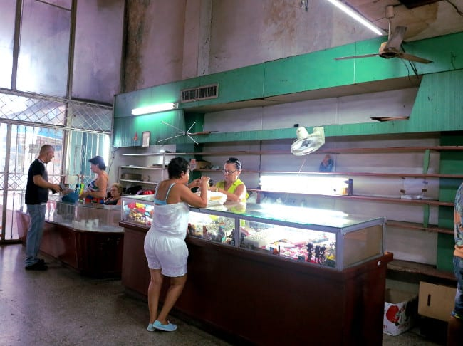 https://double-barrelledtravel.com/wp-content/uploads/2014/09/Shop-store-in-Cuba-Double-Barrelled-Travel.jpeg