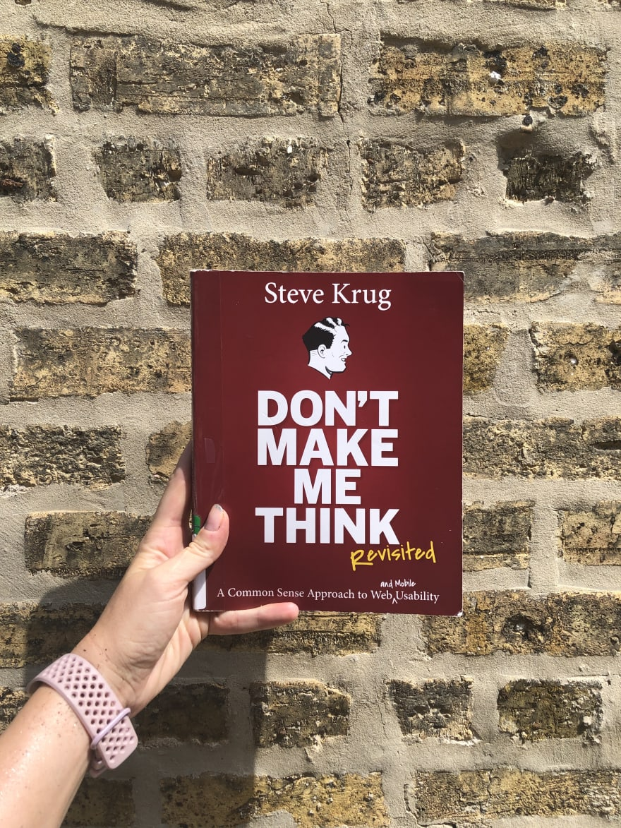 Don't Make Me Think book cover in front of a brick wall