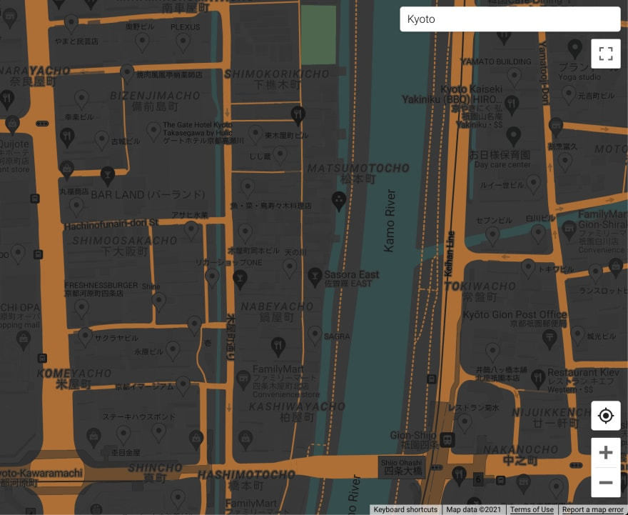 A street map with streets in dark orange, parks in dark green, rivers and canals in dark cyan and other elements in dark shades of gray