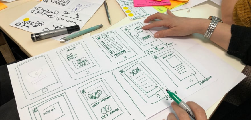 People designing an app on a big piece of paper