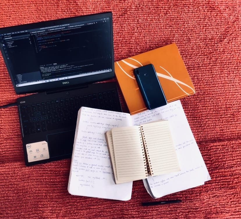 A photo of my study time with my DELL laptop, my notebooks for taking notes and my phone