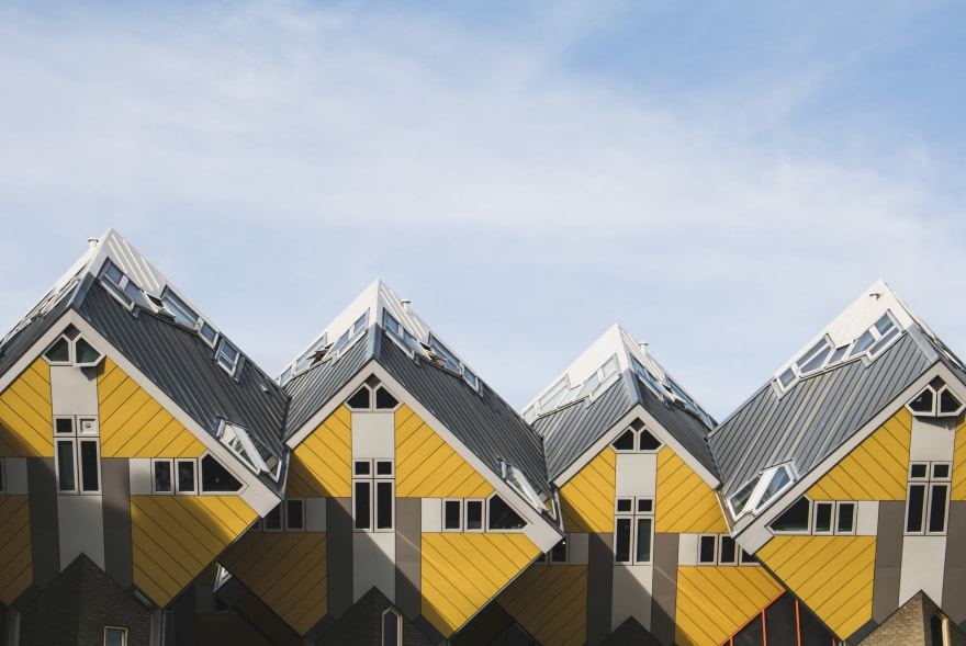 A photo of yellow and gray, cube shaped houses, at Rotterdam, The Netherlands