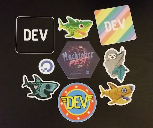 Assortment of Laptop stickers obtained from Hacktoberfest 2019