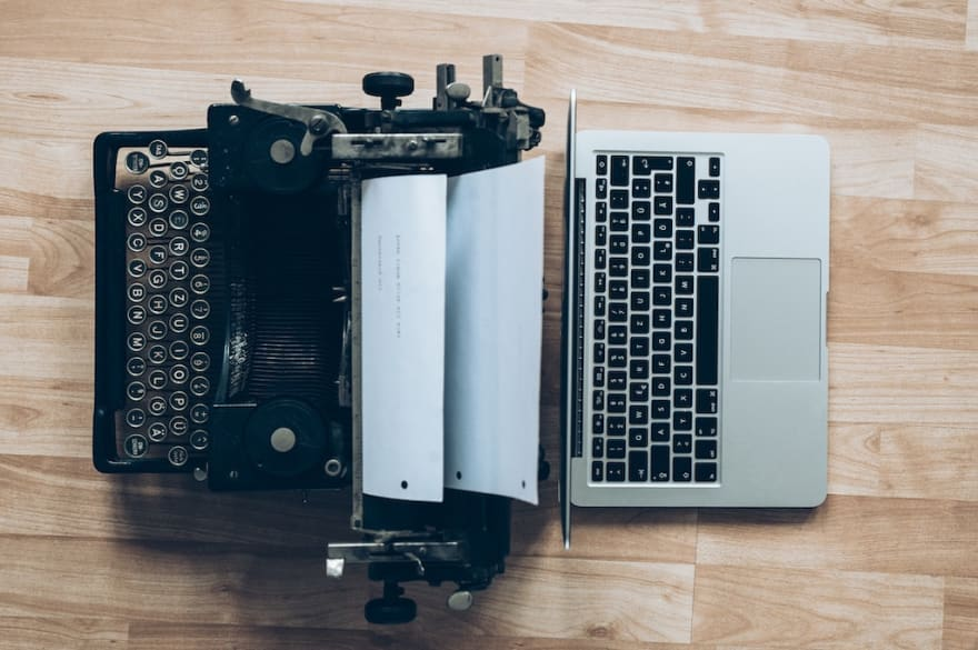a typewriter and the laptop next to each other