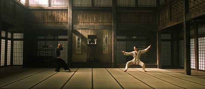 Neo and Morpheus in a dojo, ready to fight