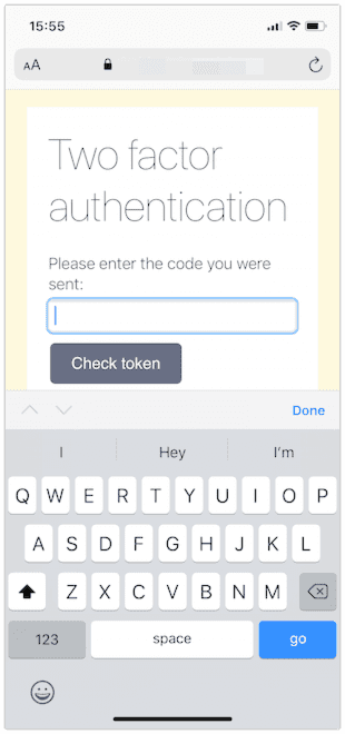 A web page shown in iOS Safari with a two factor authentication prompt. The standard alphabetical keyboard is open.