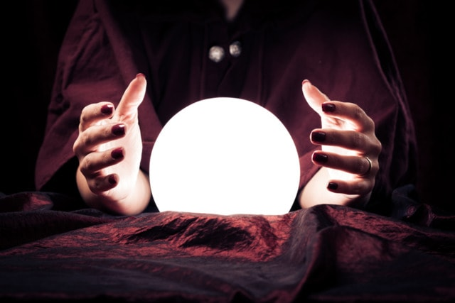 Image of a fortune teller with hands around a fortune tellers ball