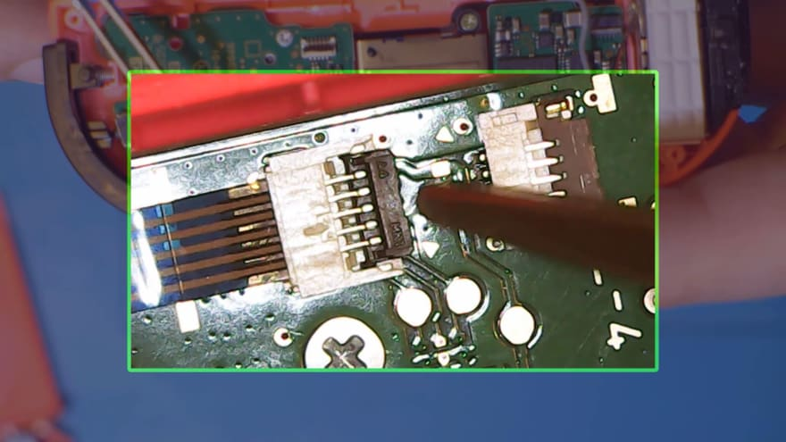 Unclipping the ribbon cables