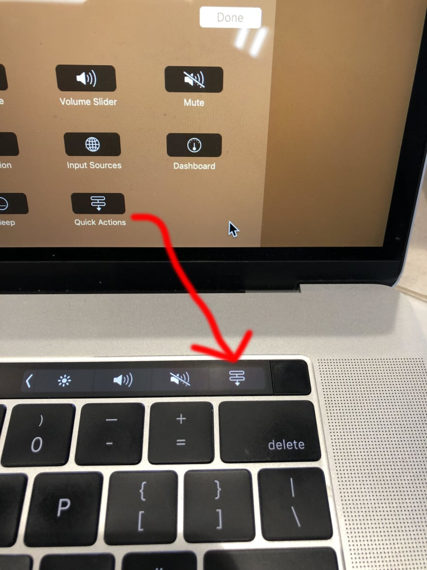 Drag the icon to your desired Touch Bar location