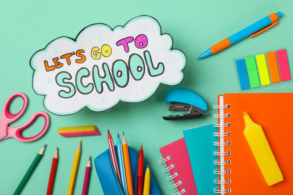 Text Let's go to school and school supplies on mint background