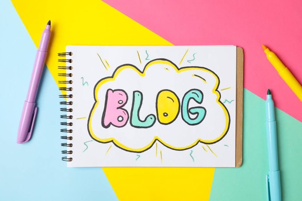 Notebook with drawing Blog on multicolor background