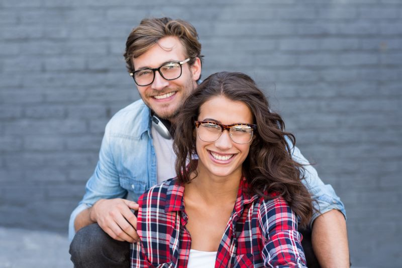 couple smiling and wearing glasses