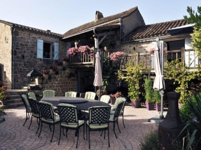 Estate of three beautifully restored stone buildings for sale with swimming pool in the Golden triangle in France