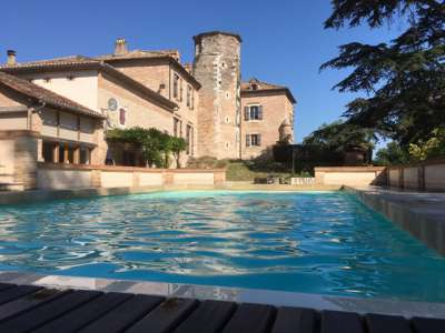 Historic French Chateau for Sale in   Gascony with Comfortable Living Space  and Income Potential