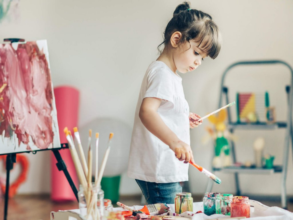 Girl painting indoors